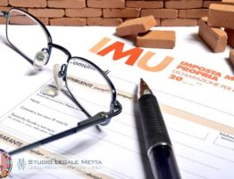 IMU form with a pair of glasses and a pen