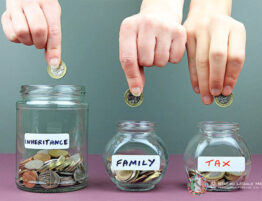 Three piggy banks with three labels: inheritance, family and tax